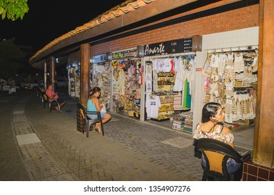 Joao Pessoa - PB, Brazil - February 21, 2019: Open air handicraft fair known as Feirinha de Artesanato de Tambau at night. Place with shops that sells crafts for tourists.