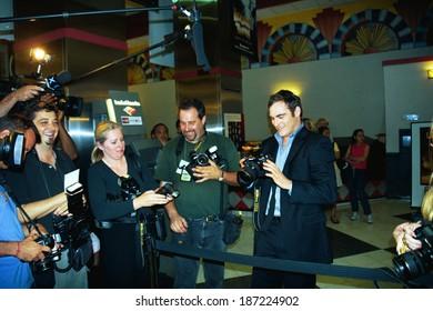 Joaquin Phoenix playing 'paparazzi' at premiere of BUFFALO SOLDIERS, NY 7/21/2003