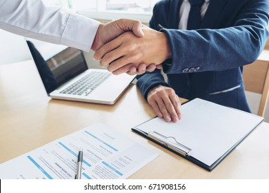 Job applicant having interview, Welcome to team Business people handshake with executive manager to Sign Approval Into the company, business meeting, Greeting deal, congratulation.