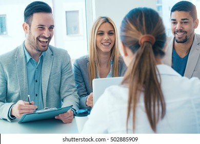 Job applicant having an interview.Group of business people having job interview with young woman. - Shutterstock ID 502885909