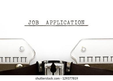 Job Application heading printed on an old typewriter.