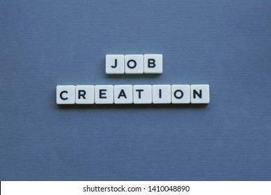 ' Job Creation ' word made of square letter word on grey background.