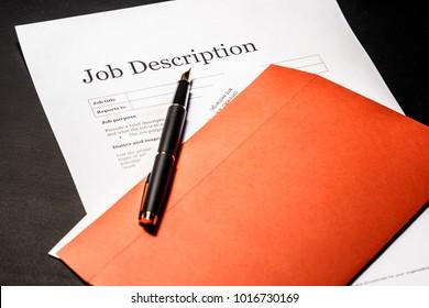 Job description and golden pen on the envelope for letters