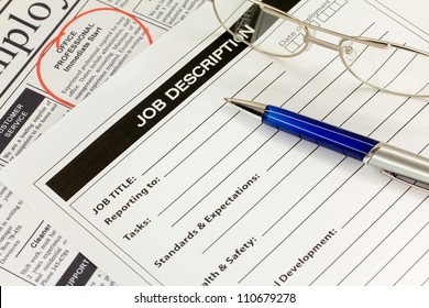 Job Description with Pen and Newspaper Ad
