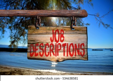 Job descriptions motivational phrase sign on old wood with blurred background