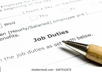 Job Duties contract with wooden pen