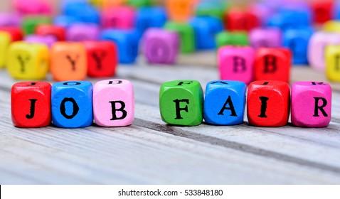 Job fair words on wooden table