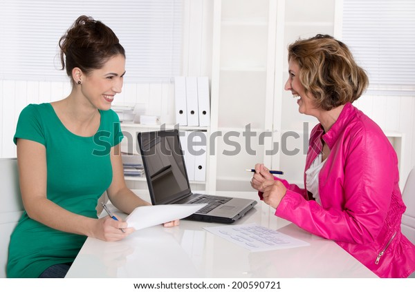 Job interview or business meeting under two woman.