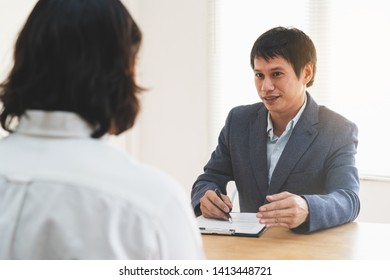 job interview concept. Businessman asking candidate applicant in interview room.