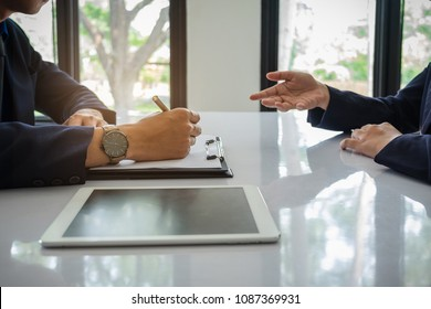 Job interview concept. Businessman has question and listen to candidate answers during interview.
