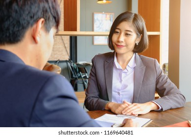 Job Interview concept. Businessman questioning and listen to candidate answers during interview.