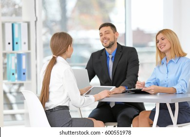 Job interview concept. Human resources commission interviewing woman