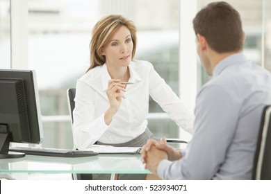 Job interview with corporate business manager in office - recruitment process