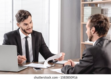 Job Interview. Employer checking application of candidate smiling positive sitting in office