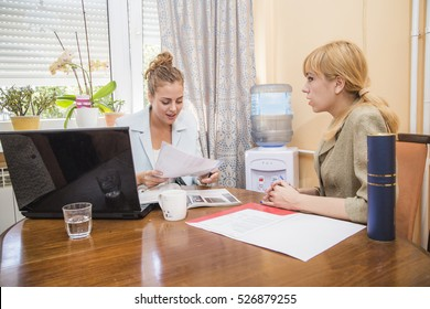 Job interview, female boss is asking questions and discussing topics with a female applicant