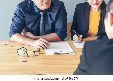 Job Interview HR human resource manager interviewing new employee candidate look at CV Resume asking job requirement question at business firm office desk. Job Interview headhunter agent application