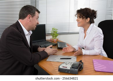 Job interview or meeting situation: business man and woman