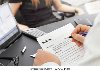 Job Interview in the office with focus on resume and pen