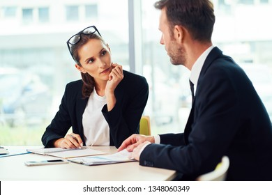 Job interview. Recruiter talking with candidate during assessment