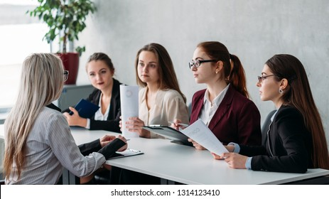 Job interview. Staffing and hiring. Blonde woman talking to recruiter team members.
