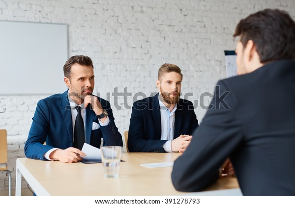 Job interview - two business man recruit candidate at their office