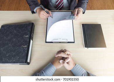 Job interview, Young attractive executives man reading his resume, work history of applicant in a clipboard, colloquy dream,  Skill, expertise, experience and businessman listen to candidate answers.