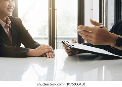 Job interview, Young executives man asking questions to applicant about work history, colloquy dream, Skill, expertise, experience and businesswoman listen to candidate answers.