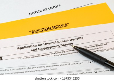 Job layoff notice, application for unemployment insurance benefits, eviction notice. Concept of Covid-19 coronavirus and stay at home order impact on economy