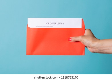 Job Offer - a letter about the successful completion of job search. A woman's hand is holding a red letter with CV.