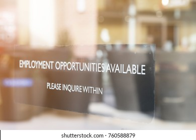 JOB OPPORTUNITIES SIGN ON SHOP GLASS WINDOW (The Image Has Shallow Depth Of Field)