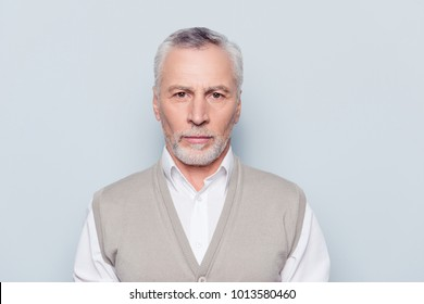 Job people age concept. Close up portrait of pensive thoughtful serious minded qualified with white bristle wrinkles old man wearing beige knitted waistcoat isolated on gray background copy-space