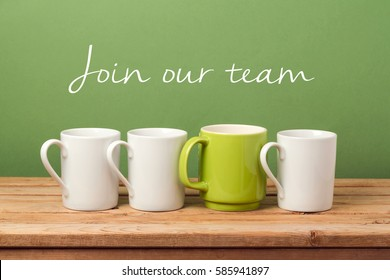 "Job recruit concept with coffee cups and text ""Join our team"". Business background"