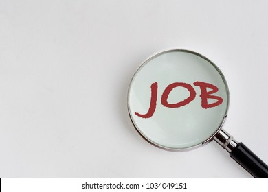 Job recruiting advertisement represented by 'JOB' text in the magnifier or magnify glass on the white background with left copyspace. It is a metaphor for job search, hiring, and recruiting positions.