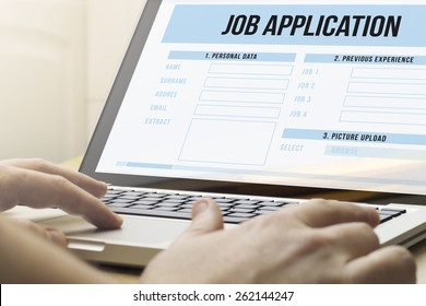 job search concept: man using a laptop with job application on the screen