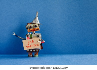 Job search concept. Robot wants to get a job. Funny unemployed robotic character with a cardboard sign and handwritten text Job wanted. Blue background, copy space.