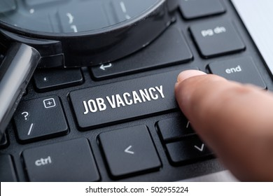 Job Vacancy, computer keyboard, magnifying glass. Human resource business concept.