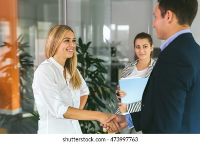 Job well done.Shot of two coworkers shaking hands in an office