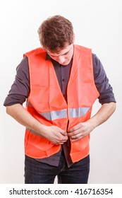 Job and work concept. Young handsome worker wearing orange uniform safety vest. Repairman inspector at work.