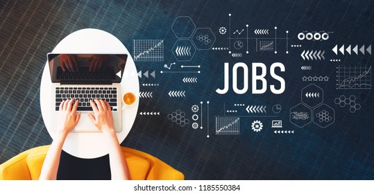 Jobs with person using a laptop on a white table