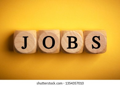 Jobs wooden blocks of business concept isolated on color background.