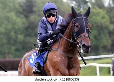 Jockey Harry Skelton guides the hooded Notnow Seamus, over the last fence at Market Rasen Races : Market Rasen Racecourse, Lincolnshire, UK : 1 June 2018 : Pic Mick Atkins