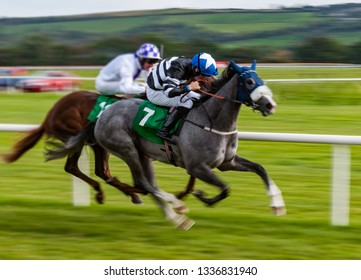 Jockey and race horse in competing in a race, speeding fast motion blur