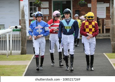 Jockeys leave the Weighing Room and enter the Parade Ring at Thirsk : Thirsk Racecourse, Thirsk, North Yorkshire, UK : 30 April 2018 : Pic Mick Atkins