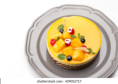 Joconde Imprime Mango and Passion fruit Mousse Cake, decorated with fresh fruits and berries