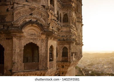 JODHPUR - INDIA - 11 MAY 2018. View of the Mehrangarh Fort during sunset with the blue city of Jodhpur in the background, Rajasthan, India. Mehrangarh Fort is one of the largest forts in India.