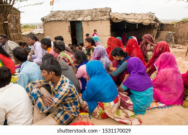 Jodhpur/ India 15 March 2019 Pakistani Hindu Refugees men women and girls are sitting on the floor at outside their family house in community meeting Jodhpur Rajasthan India
