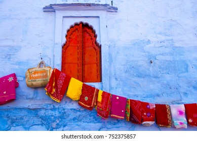 Jodhpur / India 29 October 2017 Colorful Fabric and textiles  hanging for sale at an outdoor street market in Jodhpur Rajasthan India