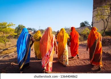 Jodhpur, India - Dec 27, 2018. Women in traditonal sari at Mehrangarh Fort in Jodhpur, India.