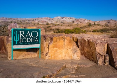 Jodhpur, India - December 31, 2018 : A Rao Jodha Park, natural ecology of a large, rocky wasteland  next to Mehrangarh Fort, name sign with desert rock background.