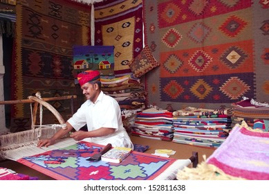 JODHPUR, INDIA - FEB 28: A craftsman uses a handloom to produce rugs on Feb 28, 2013 in Jodhpur, India. The handloom sector is known for its heritage and tradition of excellent craftsmanship of India.